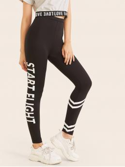 Sporty Regular Letter and Chevron Black Cropped Length Striped & Letter Graphic Leggings