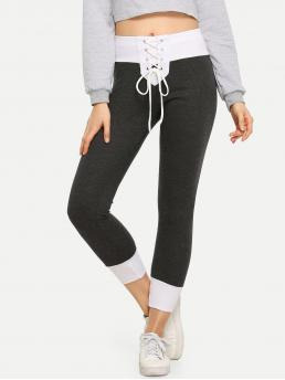 Casual Lace Up and Colorblock Sweatpants Skinny Elastic Waist Mid Waist Black and White Capris Length Lace-Up Front Color-Block Pants