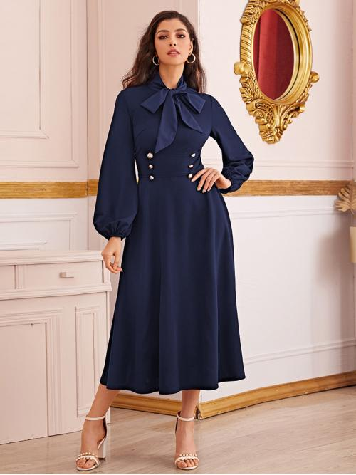 Elegant A Line Plain Flared Regular Fit Stand Collar Long Sleeve Bishop Sleeve High Waist Navy Long Length Tie Neck Double Breasted Detail Lantern Sleeve Dress
